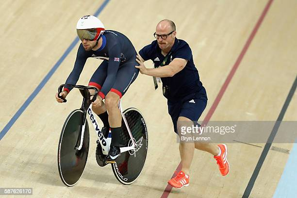 Mark Cavendish of Great Britain and Team GB gets a push up the track from coach Jan van Eijden during training at the Rio Olympic Velodrome on August...
