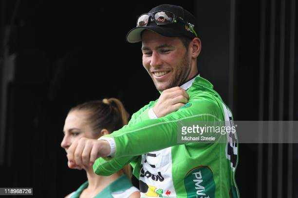 Mark Cavendish of Great Britain and Team HTC Highroad celebrates claiming the green points jersey after winning the during Stage 11 of the 2011 Tour...