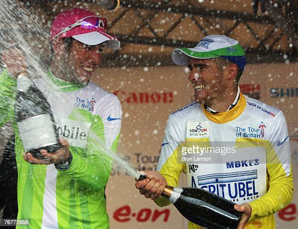 Mark Cavendish of Great Britain and T-Mobile sprays champagne after winning the points competition and race winner Romain Feillu of France and...