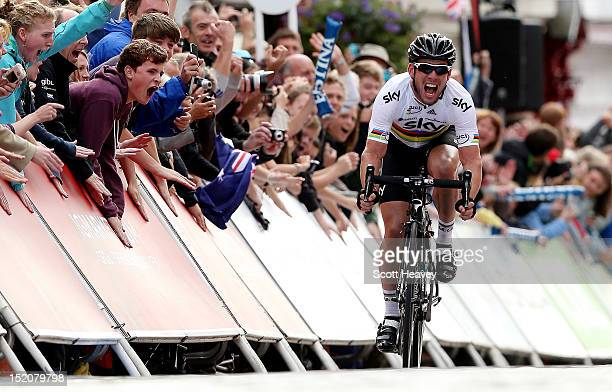Mark Cavendish of Great Britain celebrates winning the final stage of the Tour of Britain on September 16, 2012 in Guildford, England.