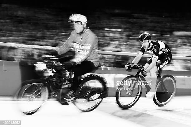 Mark Cavendish of Great Britain rides behind his derny rider on his way to winning a round of the derny race on day five of the Ghent 6 day race at...