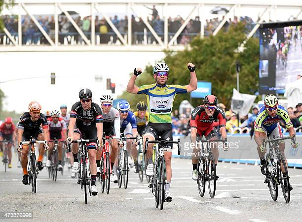 Mark Cavendish of Great Britain riding for Etixx Quickstep celebrates his first place finish ahead of Zico Waeytens of Belgium riding for Team Giant...