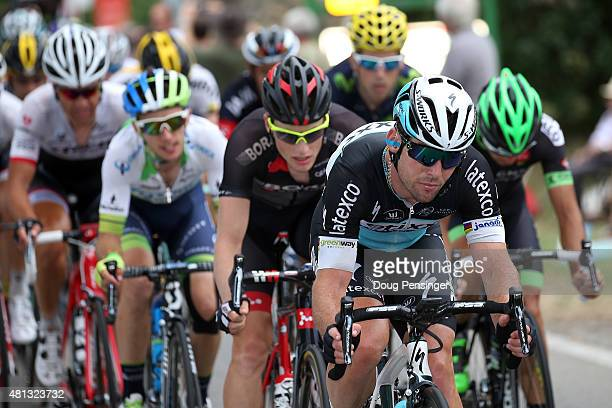 Mark Cavendish of Great Britain riding for EtixxQuickStep takes a turn on the front of the group at the back of the race as they finished more than...