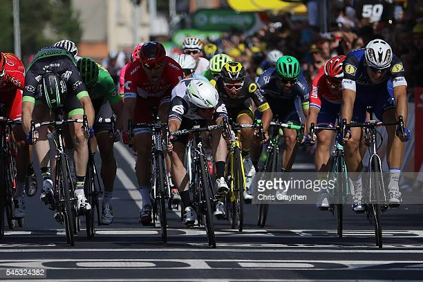 Mark Cavendish of Great Britain riding for Team Dimension Data wins stage six of the 2016 Le Tour de France a 190.5km stage from Arpajon-Sur-Cere to...