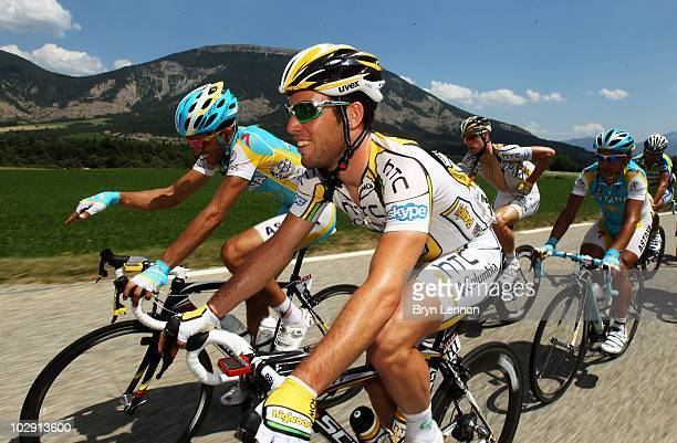 JULY 15 JULY 15 JULY 15 Mark Cavendish of Great Britian and the HTC Columbia team chats to Alberto Contador of Spain and Astana during stage eleven...