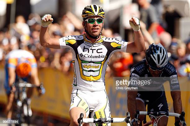 Mark Cavendish of Great Britian celebrates as he wins stage one in front of Juan Jose Haedo of Argentina of Team Saxo Bank during the Tour of...