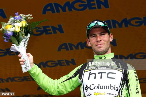 Mark Cavendish of Great Britian, riding for HTC-Columbia celebrates on the podium after winning the green points jersey after the fourth stage of the...