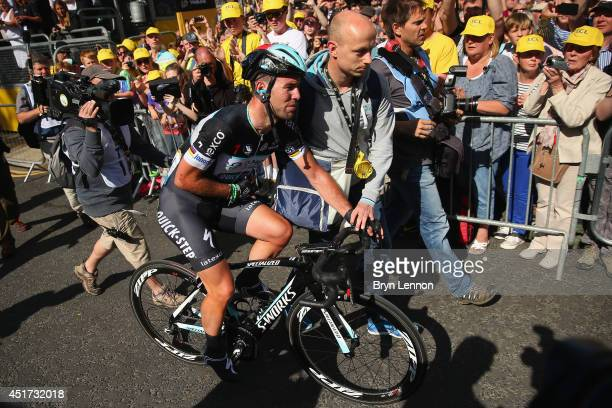 Mark Cavendish of Isle of Man and Omega Pharma-Quick Step arrives at the finishline after crashing in the first stage of the 2014 Tour de France, a...