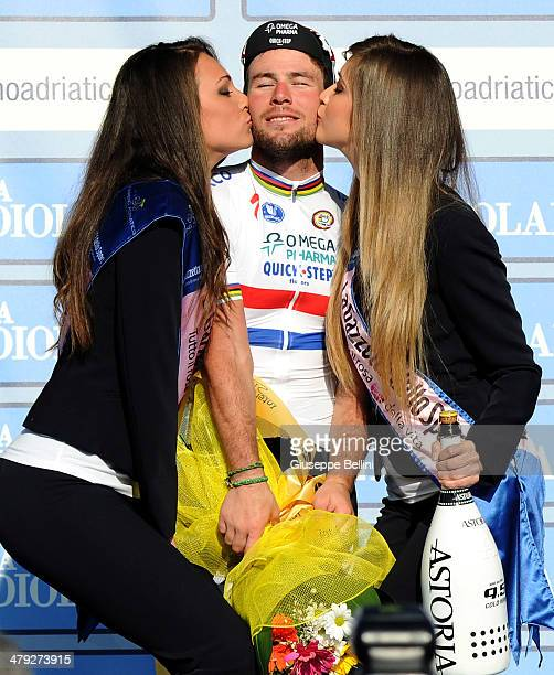 Mark Cavendish of Omega PharmaQuick Step celebrates victory on the winner's podium after stage six of the 2014 Tirreno Adriatico a 189 km stage from...