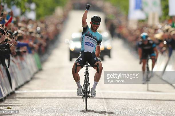 Mark Cavendish of Omega Pharma-Quickstep celebrates winning the 2013 National Mens Road Race Championships on June 23, 2013 in Glasgow, Scotland.