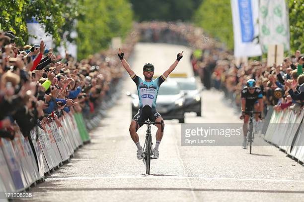 Mark Cavendish of Omega Pharma-Quickstep celebrates winning the 2013 National Mens Road Race Championships on June 23, 2013 in Glasgow, Scotland.