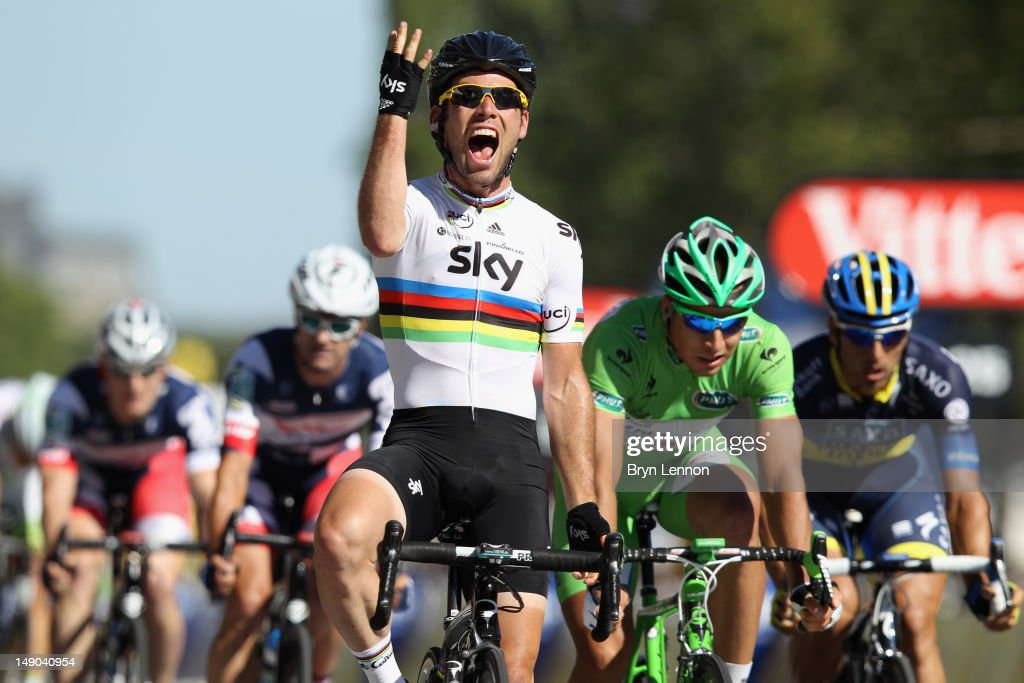 Mark Cavendish of SKY Procycling celebrates as he crosses the finish line to win the bunch sprint during the twentieth and final stage of the 2012 Tour de France, from Rambouillet to the Champs-Elysees on July 22, 2012 in Paris, France.