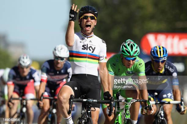 Mark Cavendish of SKY Procycling celebrates as he crosses the finish line to win the bunch sprint during the twentieth and final stage of the 2012...
