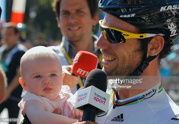 Mark Cavendish of SKY Procycling holds his daughter after he wins the bunch sprint during the twentieth and final stage of the 2012 Tour de France...