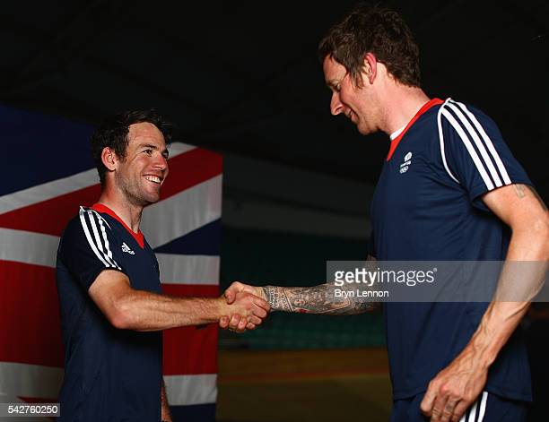 Mark Cavendish of Team GB chats to Bradley Wiggins at a press conference announcing the Team GB track cyclists selected to ride in the Rio 2016...