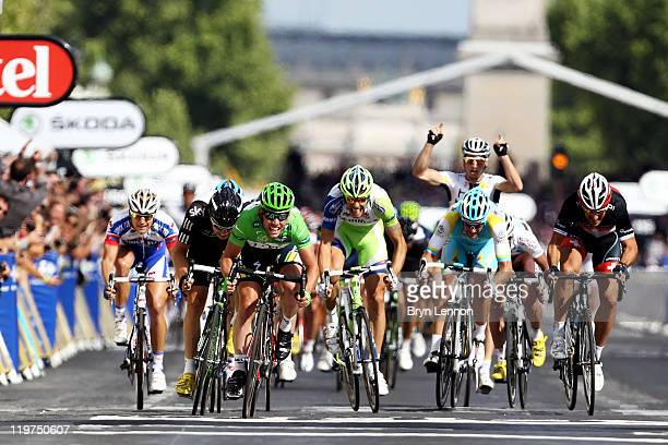 Mark Cavendish of team HTC sprints to win the final sprint and the green points jersey during the twenty first and final stage of Le Tour de France...