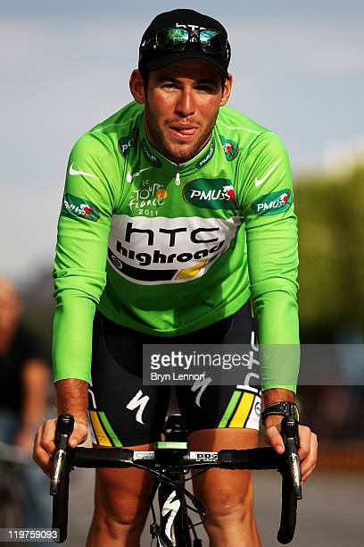 Mark Cavendish of team HTC takes part n a victory parade after winning green points jersey after the twenty first and final stage of Le Tour de...