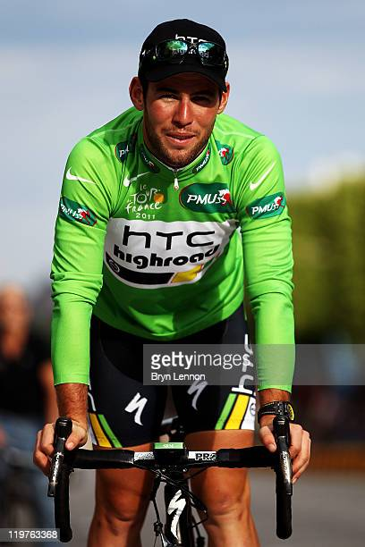 Mark Cavendish of team HTC takes part n a victory parade after winning the green points jersey after the twenty first and final stage of Le Tour de...