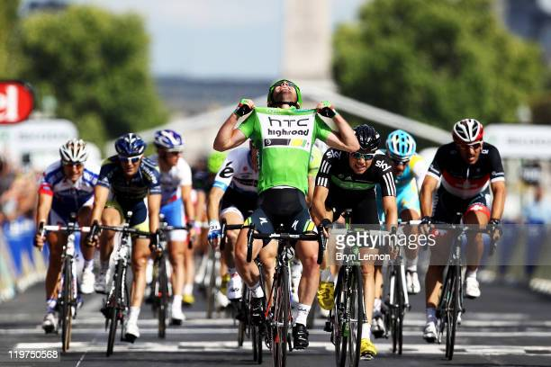 Mark Cavendish of team HTC wins the final sprint and the green points jersey during the twenty first and final stage of Le Tour de France 2011, from...