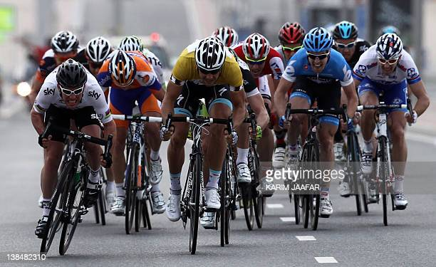Mark Cavendish of team Sky sprints clear of Tom Boonen of team Omega Pharma Qucik-Step during 146 kilometre third stage of the Tour of Qatar cycling...