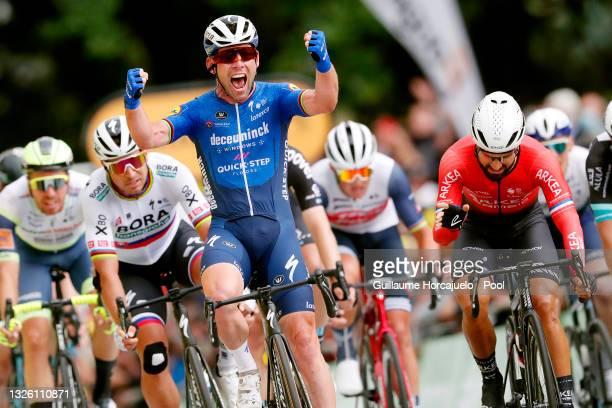 Mark Cavendish of The United Kingdom and Team Deceuninck - Quick-Step stage winner celebrates at arrival, Peter Sagan of Slovakia and Team BORA -...