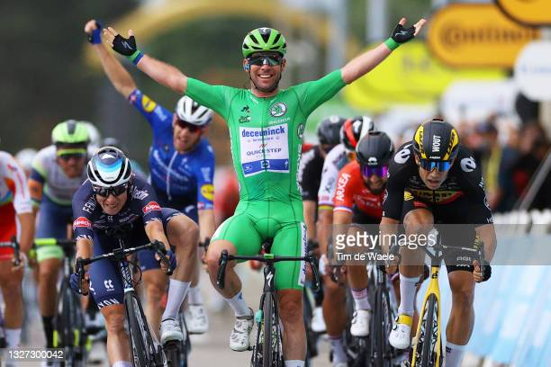 Mark Cavendish of The United Kingdom and Team Deceuninck - Quick-Step Green Points Jersey Green Points Jersey stage winner celebrates at arrival,...
