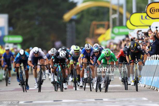 Mark Cavendish of The United Kingdom and Team Deceuninck - Quick-Step Green Points Jersey Green Points Jersey, Wout Van Aert of Belgium and Team...