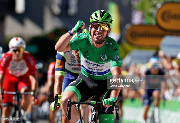 Mark Cavendish of The United Kingdom and Team Deceuninck - Quick-Step Green Points Jersey celebrates at arrival during the 108th Tour de France 2021,...