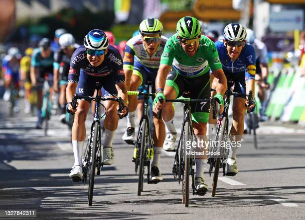 Mark Cavendish of The United Kingdom and Team Deceuninck - Quick-Step Green Points Jersey celebrates at arrival ahead of Jasper Philipsen of Belgium...