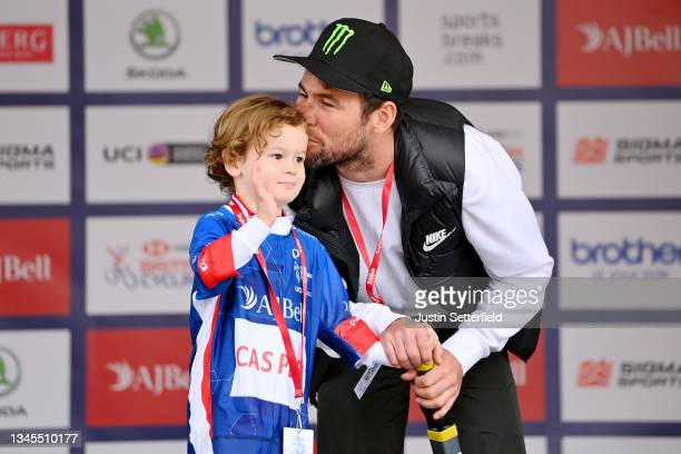 Mark Cavendish of United Kingdom and Team Deceuninck - Quick-Step accompanied by his son Frey David Cavendish on the podium ceremony after the 7th...