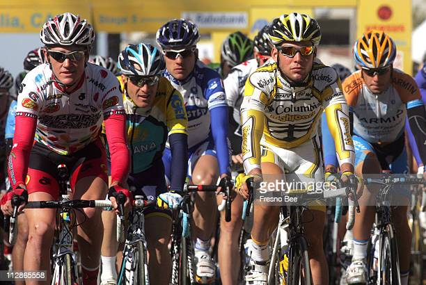 Mark Cavendish right of the Columbia High Road rolls out with race leader Levi Leipheimer smiling in the blue helmet at the start of the 5th stage of...