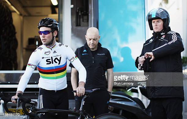 Mark Cavendish, Team Principal Dave Brailsford and Race Coach Rod Ellingworth look on during a pre-season Team SKY training camp in Puerto Alcudia on...