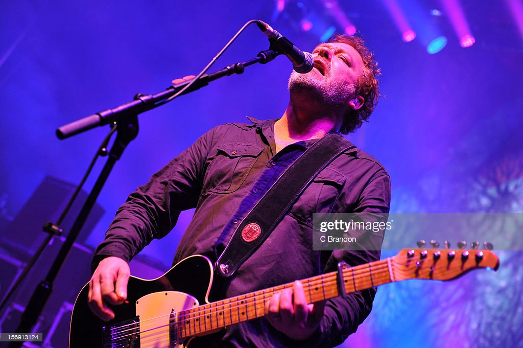 Mark Chadwick of The Levellers performs on stage at O2 Shepherd's Bush Empire on November 24, 2012 in London, England.