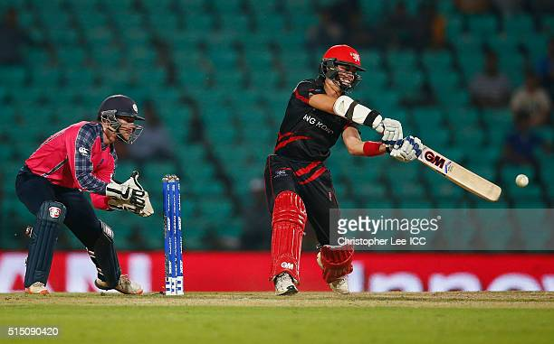 Mark Chapman of Hong Kong in action with Matthew Cross of Scotland during the ICC Twenty20 World Cup Round 1 Group B match between Scotland and Hong...