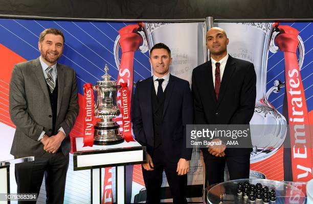 Mark Chapman of the BBC Robbie Keane and Carl Ikeme both former player of Wolverhampton Wanderers attend the FA Cup Fourth Round Draw at Molineux...
