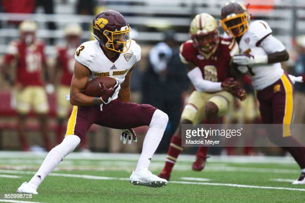 Mark Chapman of the Central Michigan Chippewas carries the ball against the Boston College Eagles during the second half at Alumni Stadium on...