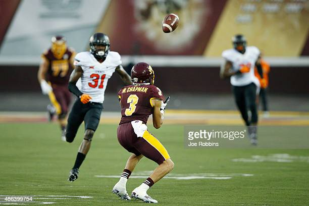 Mark Chapman of the Central Michigan Chippewas makes a 40-yard reception on a trick play in the first half of the game against the Oklahoma State...