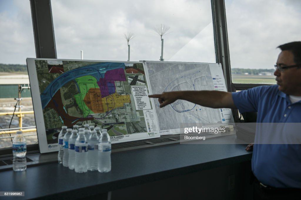 Mark Chaput, vice president of construction for the American Center for Mobility, points to future construction during a visit by Representative Debbie Dingell, a Democrat from Michigan, and Representative Bob Latta, a Republican from Ohio, not pictured, at the ACM facility in Ypsilanti, Michigan, U.S., on Tuesday, Aug. 15, 2017. Representative Dingell and Representative Latta visited the ACM to meet with experts in the autonomous vehicles industry as the two work together to advance bipartisan self-driving vehicle legislation through the House floor. Photographer: Sean Proctor/Bloomberg via Getty Images