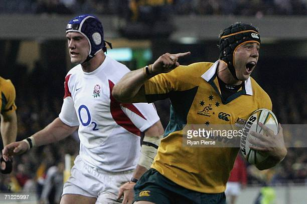 Mark Chisholm of the Wallabies celebrates while scoring a try as Chris Jones of England looks dejected during the Second Cook Cup match between the...