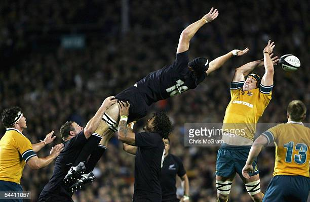 Mark Chisholm of the Wallabies grabs a lineout from James Ryan of the All Blacks during the Tri Nations series Bledisloe Cup match between the New...