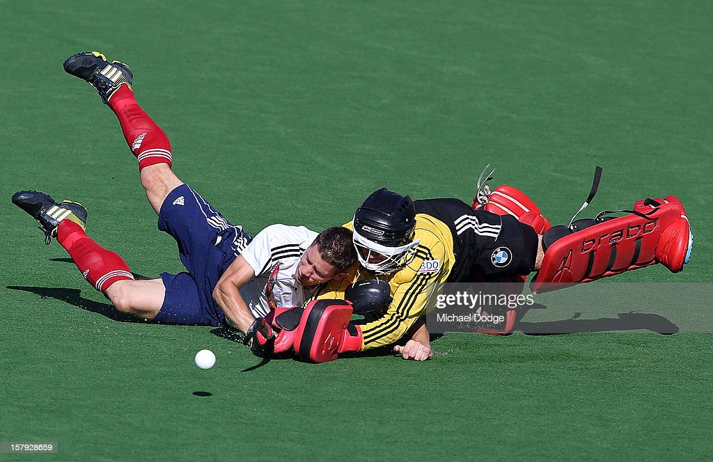 Mark Cleghorne of England injures his shoulder against goal keeper Jeremy Gucassoff of Belgium in the match between England and Belgium during day five of the 2012 Champions Trophy at the State Netball and Hockey Centre on December 8, 2012 in Melbourne, Australia.