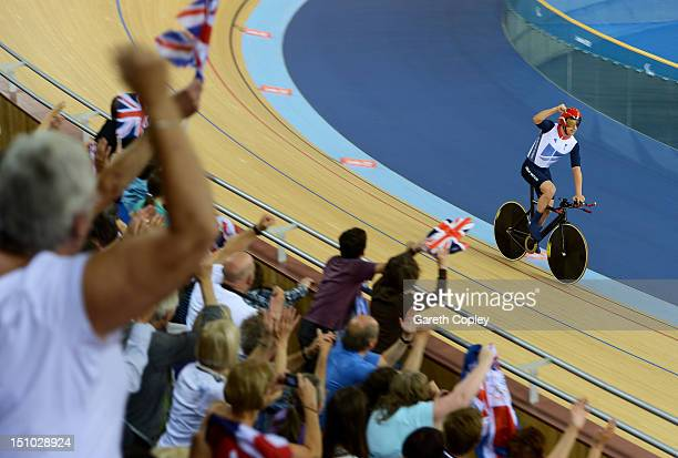 Mark Colbourne of Great Britain celebrates after setting a new world record time of 353970 in the Men's Individual Cycling C1 Pursuit qualification...