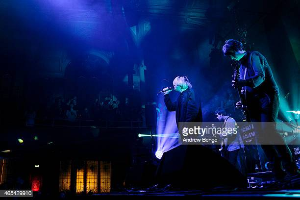 Mark Collins Tim Burgess and Martin Blunt of The Charlatans perform on stage at Albert Hall on March 6 2015 in Manchester United Kingdom