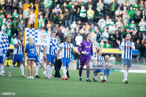 Mark Connolly Kilmarnock leads the teams out ahead of the Scottish premiership match between Kilmarnock and Celtic at Rugby Park on August 12 2015 in...