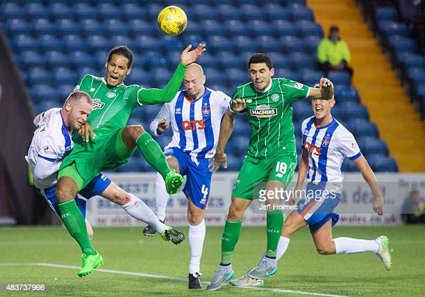 Mark Connolly of Kilmarnock brings down Virgil Van Dijk of Celtic during the Scottish premiership match between Kilmarnock and Celtic at Rugby Park...