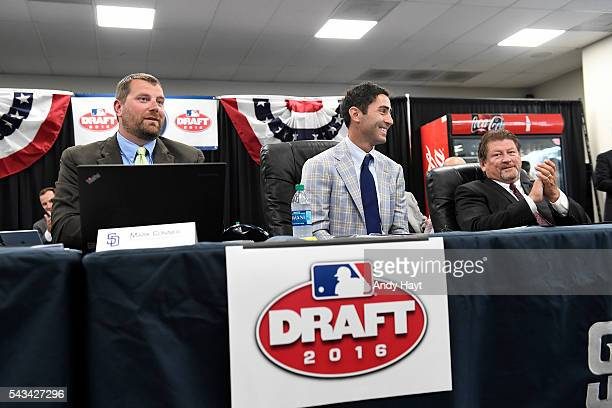 Mark Connor AJ Preller and Logan White of the San Diego Padres after the selection of the team's first overall draft pick Cal Quantrill in the 2016...