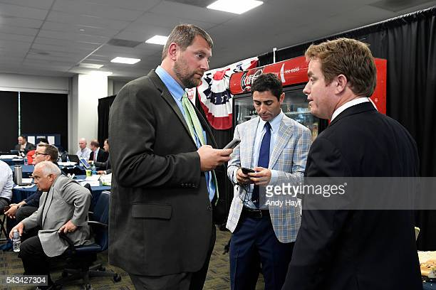 Mark Connor talks with AJ Preller and Josh Stein of the San Diego Padres as they partake in the 2016 MLB Amateur Draft at PETCO Park on June 9 2016...
