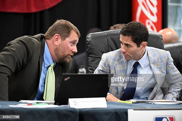 Mark Connor talks with AJ Preller of the San Diego Padres as they partake in the 2016 MLB Amateur Draft at PETCO Park on June 9 2016 in San Diego...