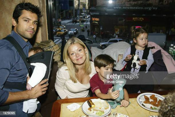 Mark Consuelos and baby Juoaquin wife Kelly Ripa son Michael and daughter Lola celebrate at the Opening Night Party for A Year With Frog and Toad at...