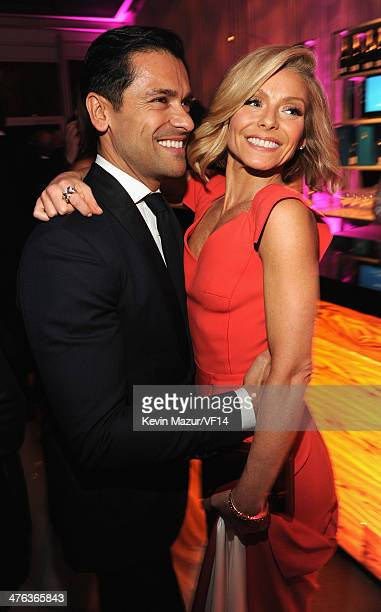 Mark Consuelos and Kelly Ripa attend the 2014 Vanity Fair Oscar Party Hosted By Graydon Carter on March 2 2014 in West Hollywood California